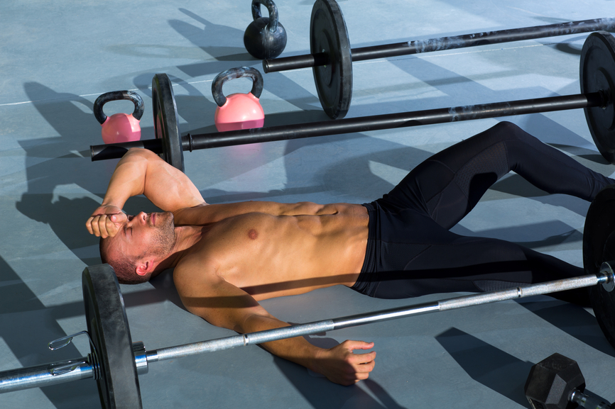 crossfit man tired relaxed after workout exercise